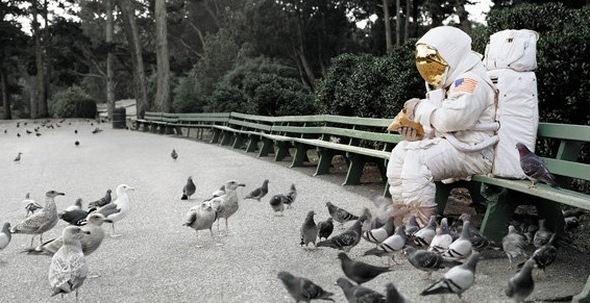 astronaut feeds pigeons