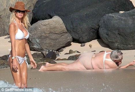 Playboy playmate in white bikini