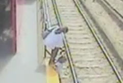 Mother put a doughter on railway track