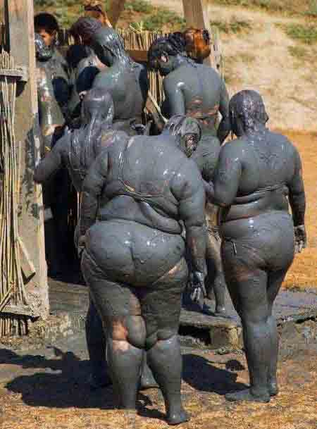 funny group of muddy people