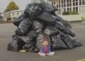 Child on garbage wallpaper