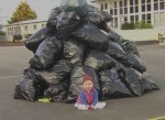 Child on garbage wallpaper